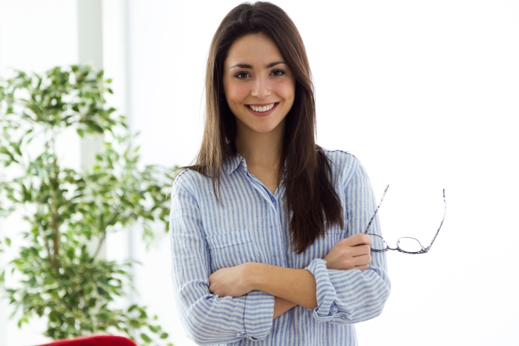 Business young woman looking at camera in the office.